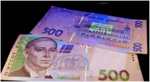 Банкиры напомнили запорожцам, как распознать фальшивые купюры