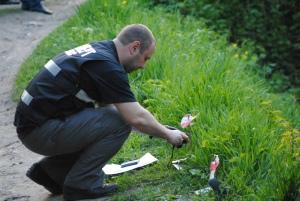 Фоторепортаж с места ограбления банка в Шевченковском районе, во время которого были ранены патрульные