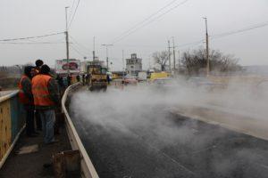 Ремонт дороги на плотине ДнепроГЭСа обещают закончить в кратчайшие сроки - ФОТО
