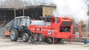 В Запорожье дорожники проводят аварийный ямочный ремонт с использованием спецтехники