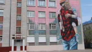 На фасадах трех запорожских школ появились муралы - ФОТО