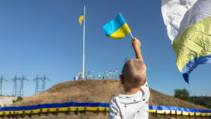 У Запоріжжі на Хортиці розгорнули рекордний 100-метровий прапор України, –  ФОТОРЕПОРТАЖ